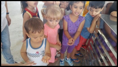 The children were given samples of the aloe vera gel to feel. They then were shown how to rub the gel between the palms and on the arms for a cooling effect.