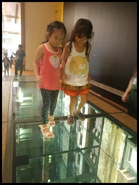 The third exhibit is named Firewalk: A Bridge of Embers by Mark Justiniani. By using mirrors and different items, he has created an illusion of depth. When asked about how the children felt while walking on the 12-meter long bridge, some of them admitted to feeling a little frightened but that they felt much better after having done it.