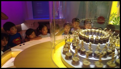 The children watched in fascination as the trophies were spun around in strobe lighting, creating a 'motion' effect that made it seem as though the statues on the trophies were 'running'.
