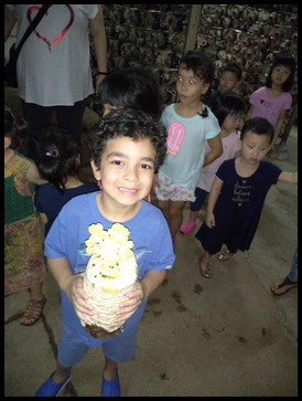 The children explored the mushroom farm and held the bags of mushrooms grown in a mixture of sawdust, corn and rice husks
