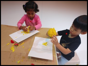 The children were given Roses, a Marigold and a sheet of paper to try see how these flowers can be used to produce colour. They were asked to put the petals on one side of the sheet.
