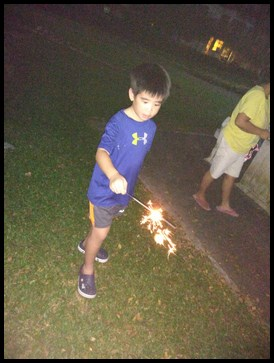 Happily playing with sparklers