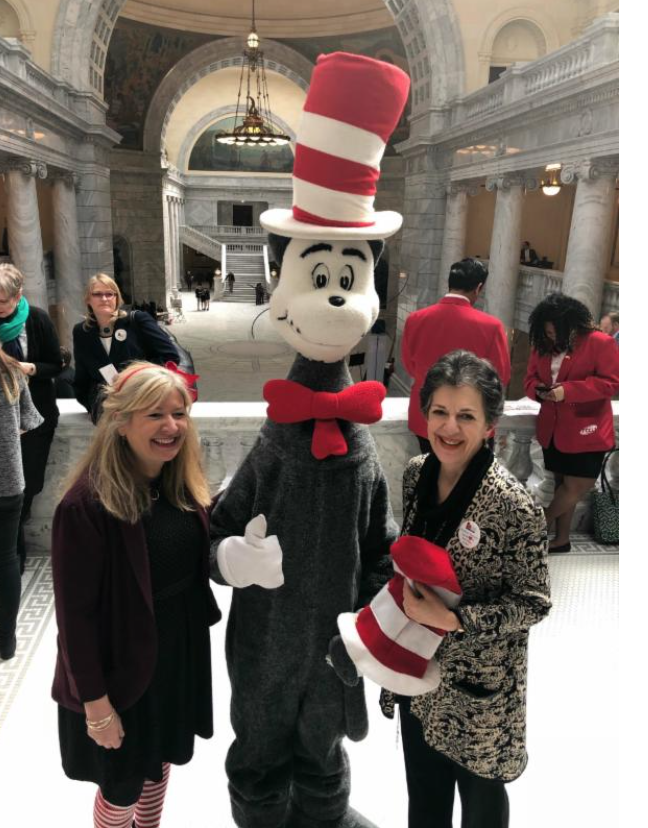 """Utah Education Association President Heidi Matthews, the Cat in the Hat, and Rep. Arent on the birthday of Dr. Seuss, which the National Education Association honors as """"Read Across America Day"""""""