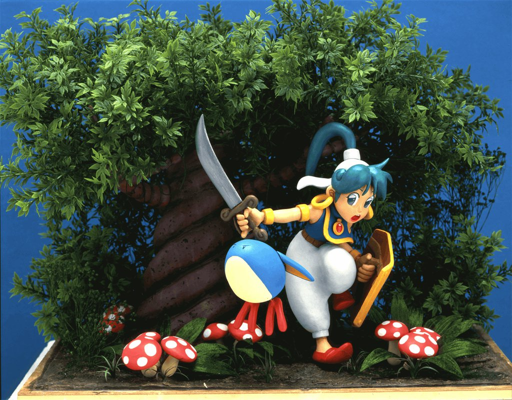 Questo delizioso modellino di Asha e Pepelogoo è servito come soggetto per la cover della cartuccia originale per Megadrive.