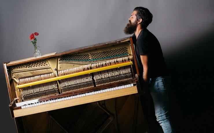 man-moving-piano.jpg