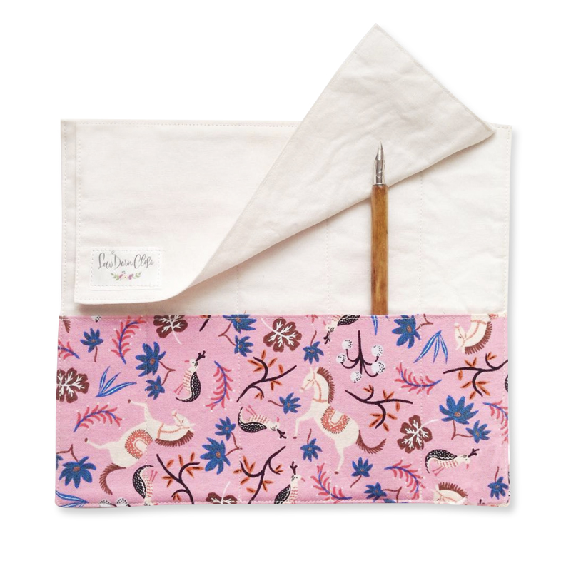 "<p><strong><a href=""https://www.etsy.com/shop/SewDarnClose/items?section_id=18985722"" target=""_blank"">Sew Darn Close Calligrapher's Clutch</a></strong>$30.00+</p>"