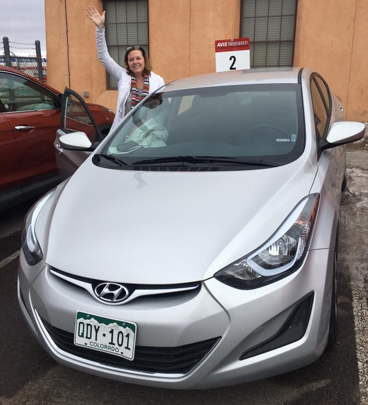 Dreamy Wife getting into the spirit of an unexpected 800-mile drive in the rarest of beasts: An available rental car in Sante Fe, NM.