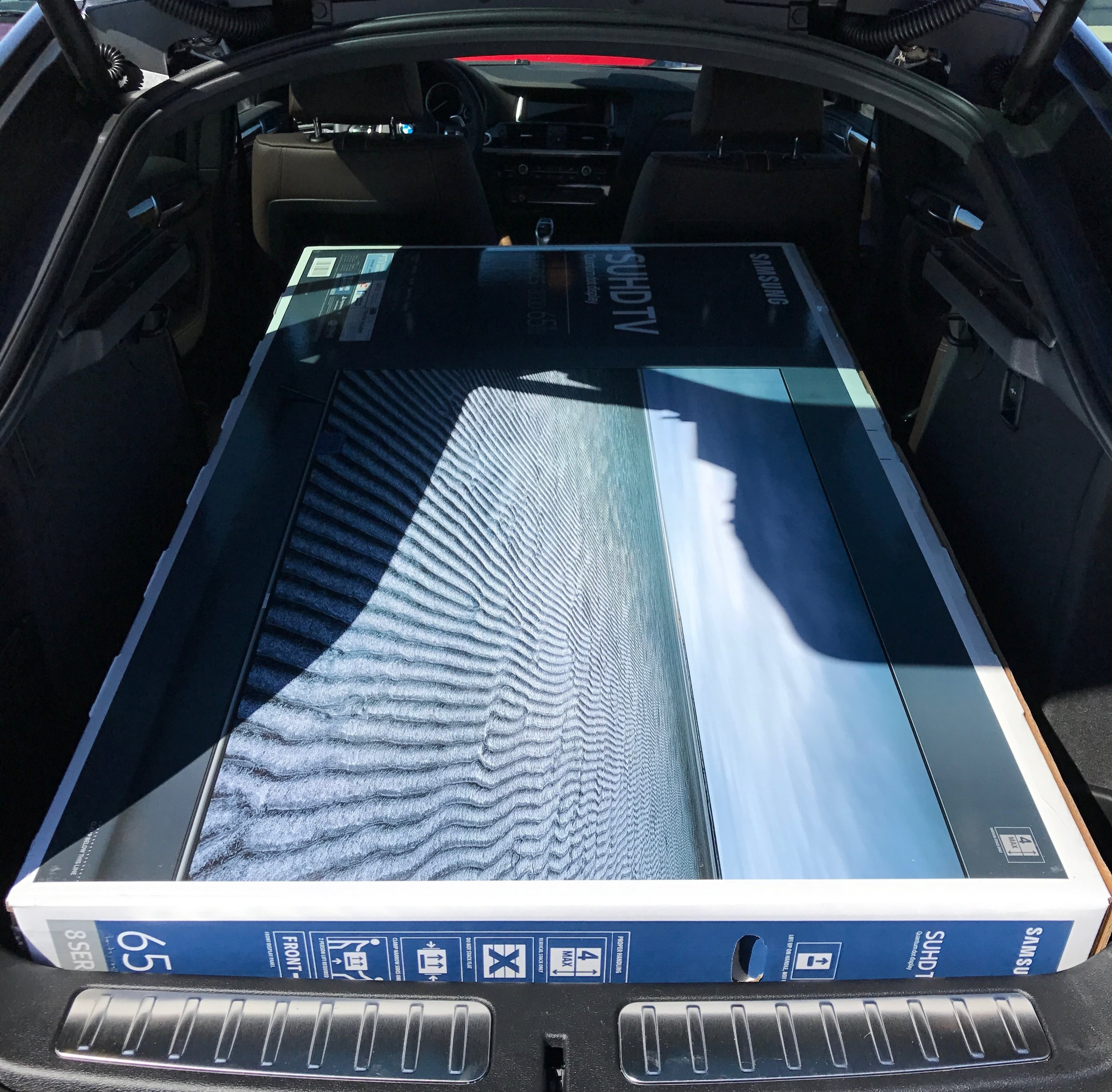 The M40i swallows massive boxes for purposes of load testing.