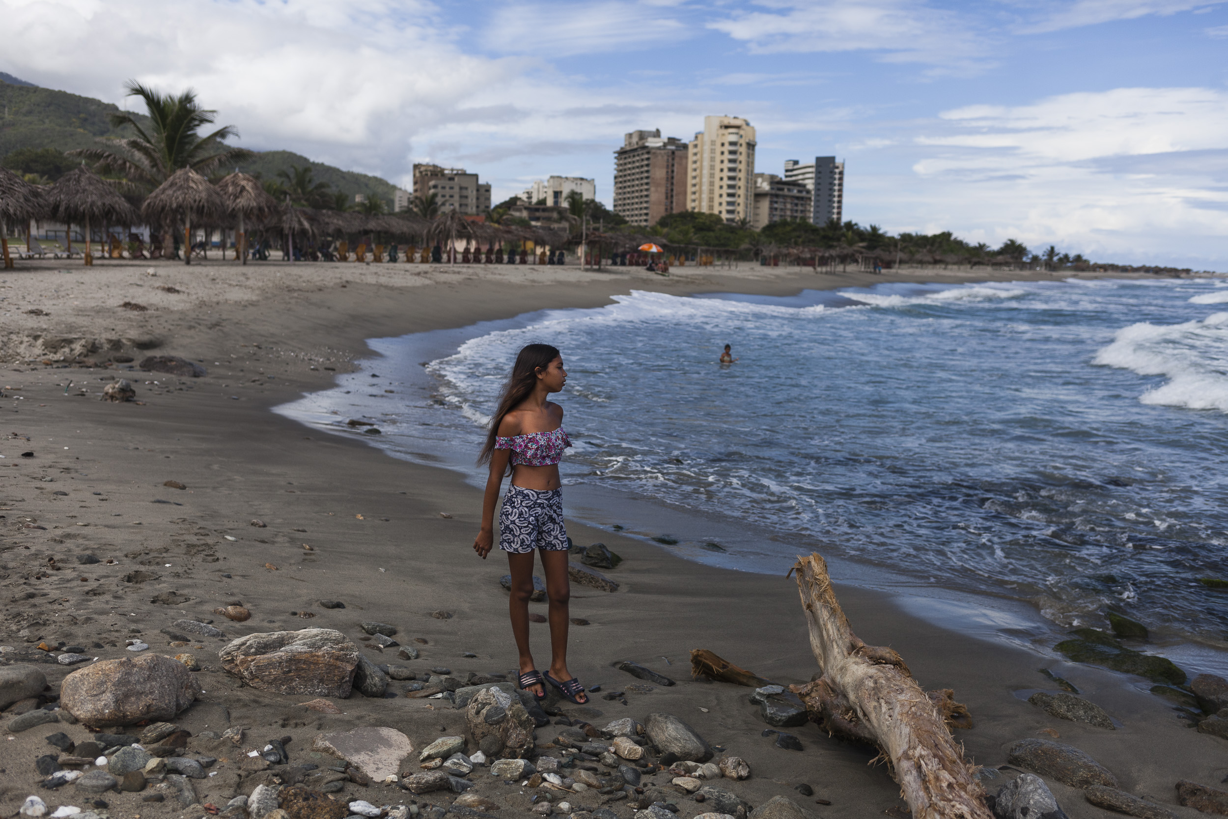 Mileska, 13, looks at the sea in Vargas, Venezuela.