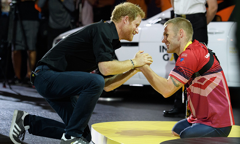 Mark with Prince Harry after the claiming silver medal in the rowing at the Invictus Games, 2017.