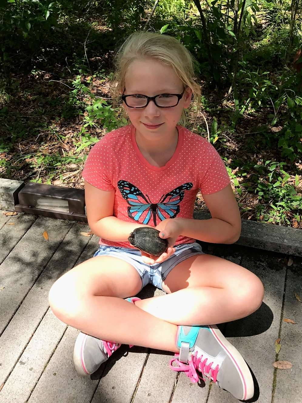 Chloe holding species #43 for The Big Turtle Year, an adult female striped mud turtle ( Kinosternon   baurii ) at Brooker Creek Preserve (Tarpon Springs, Florida). Photograph by Andrew Farren.