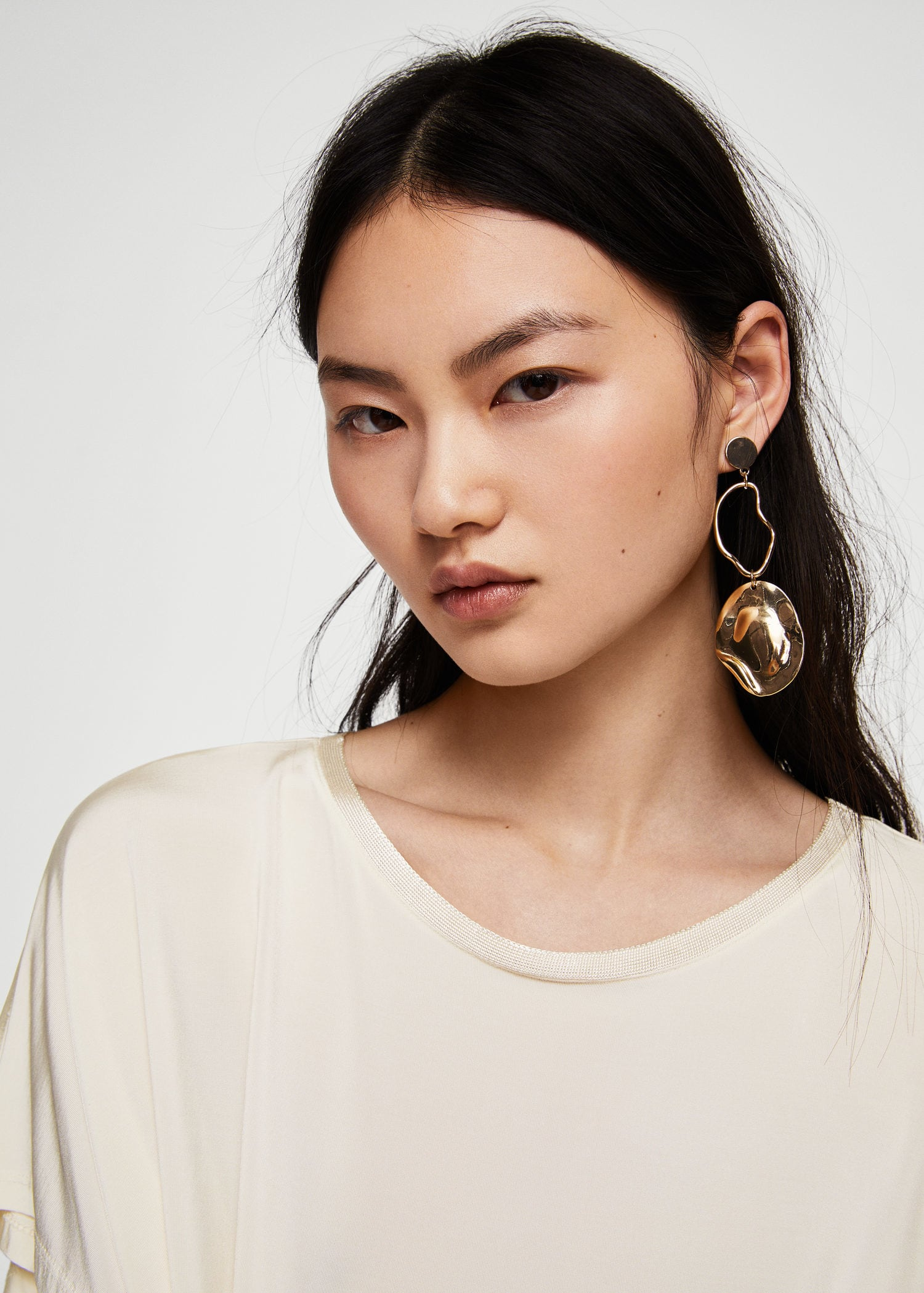 Metallic Hoop Earrings - £12.99, MangoI'm not huge on jewellery, but my ethos is normally go big or go home - and these asymmetrical earrings from Mango definitely fit the bill. Mango's been killing the accessory game recently and these big dangling knockouts only reaffirm it.I'd probably wear these with a relatively minimal outfit and strike out all the other accessories. These are such statement pieces that you gotta give them their time in the sun.