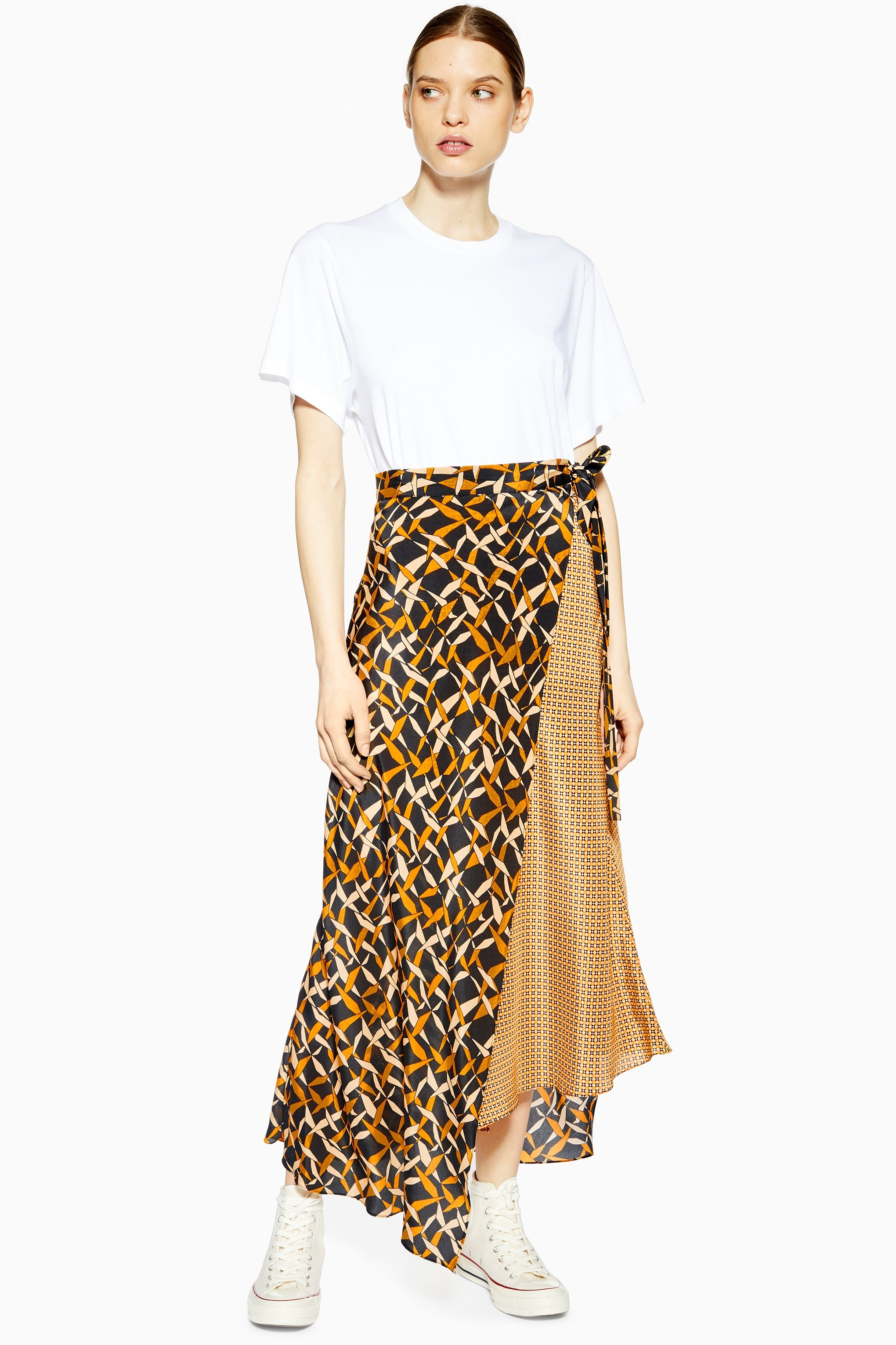 Geometric Silk Skirt - While Topshop once had millions of bog standard satin skirts, they've deviated on the silhouette slightly with these fun asymmetric wrap styles. I'm really into this mixed scarf print one (and not just because it's on sale).Priced at £45, available at Topshop
