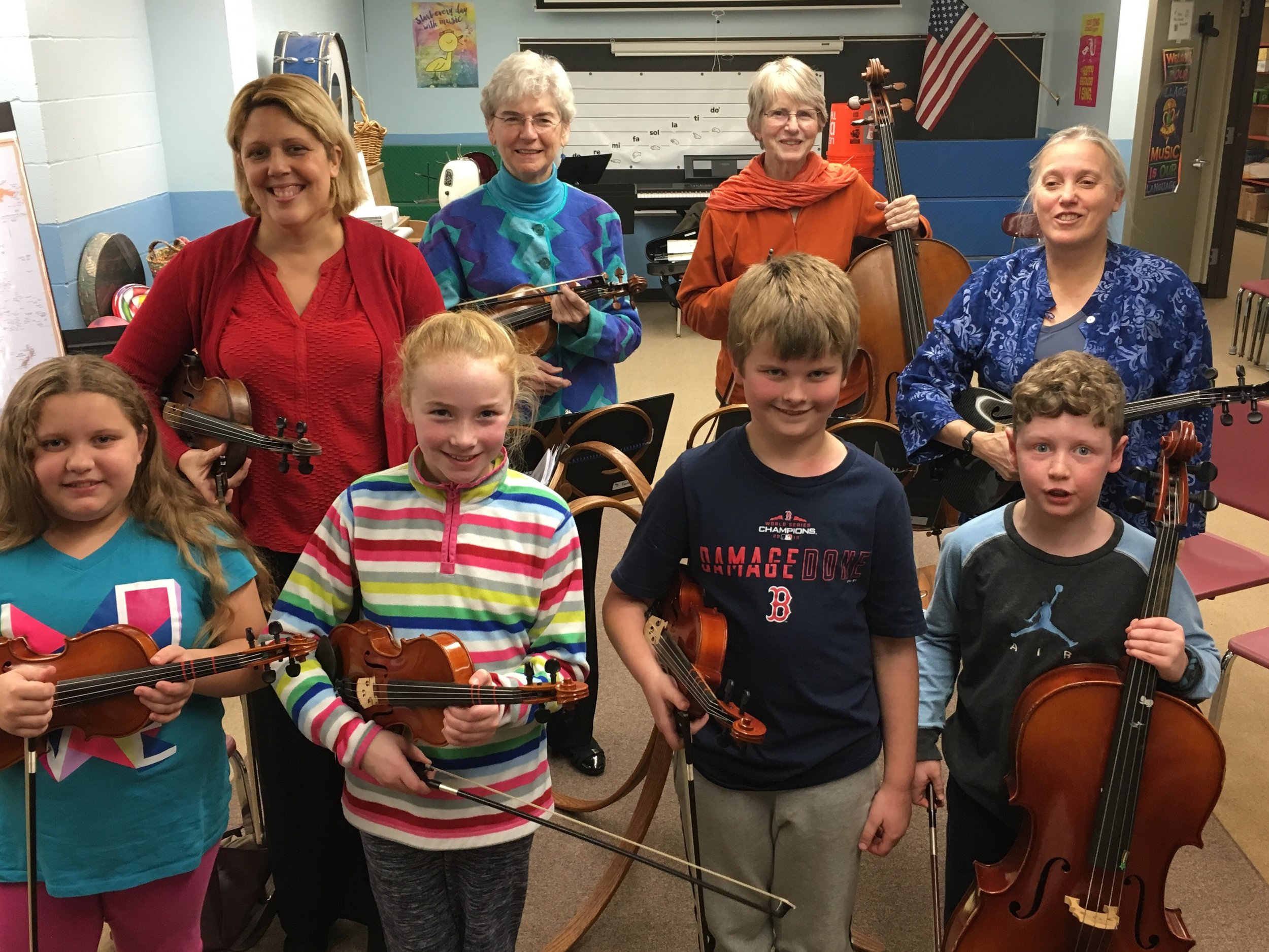 The MITS string quartet. Wendy Rios, Pat Petersen, Bunny Reardon, Diane Guillemette .,  with children from Fishing cove elementary school, north kingstown, ri.