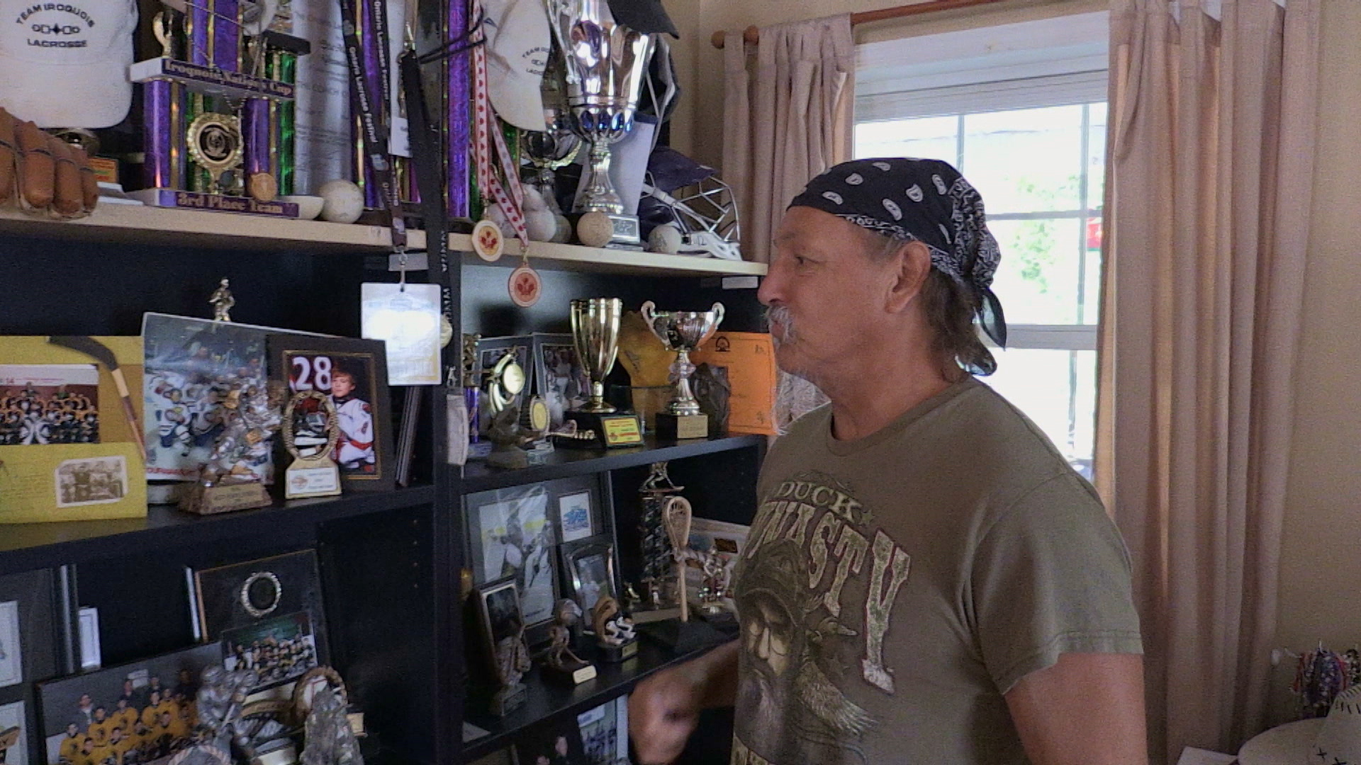 Dirt and his trophies.  1920 x 1080 film still.
