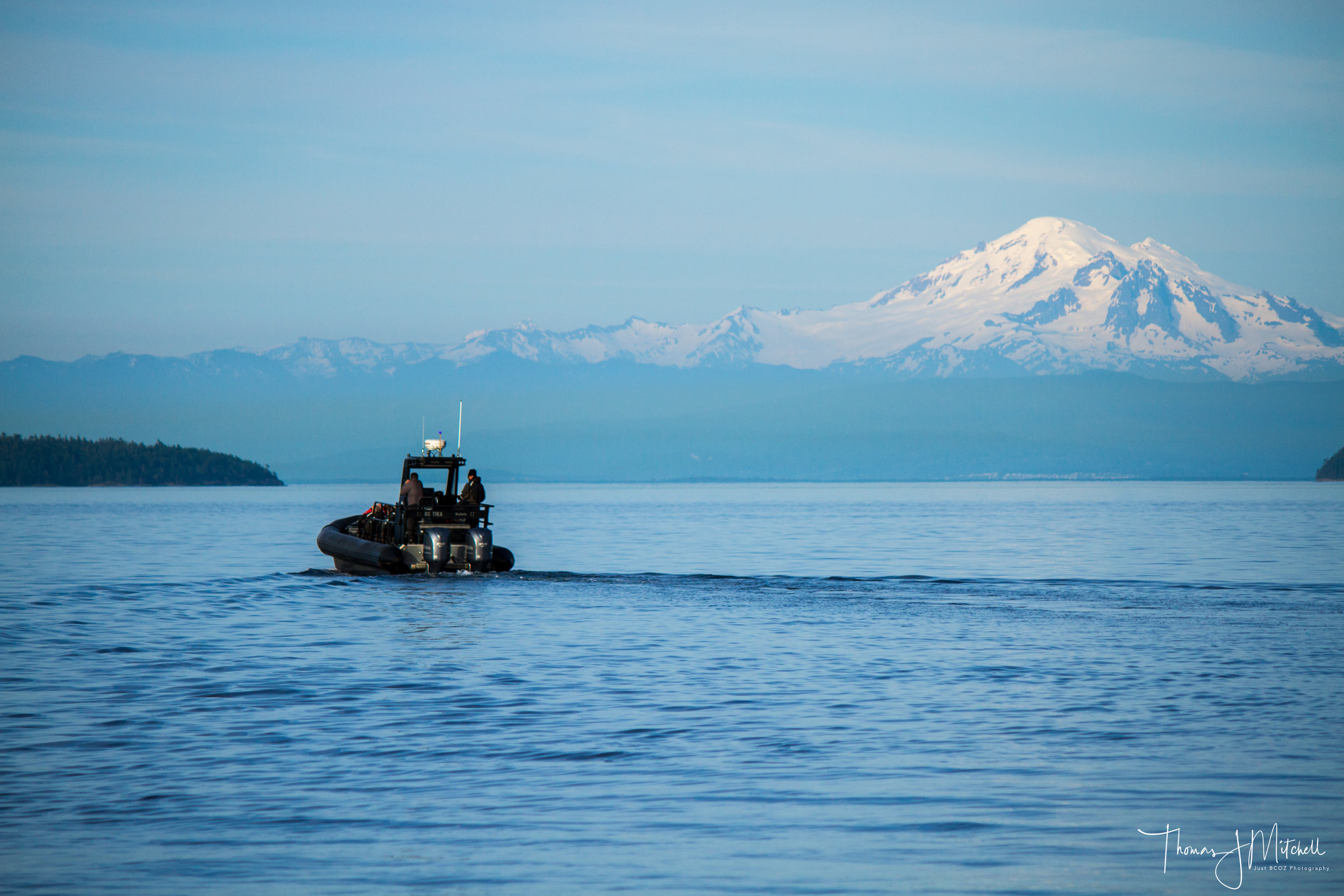 BC TIKA with Capt. Gordon at the helm ~ Mt. Baker in the background
