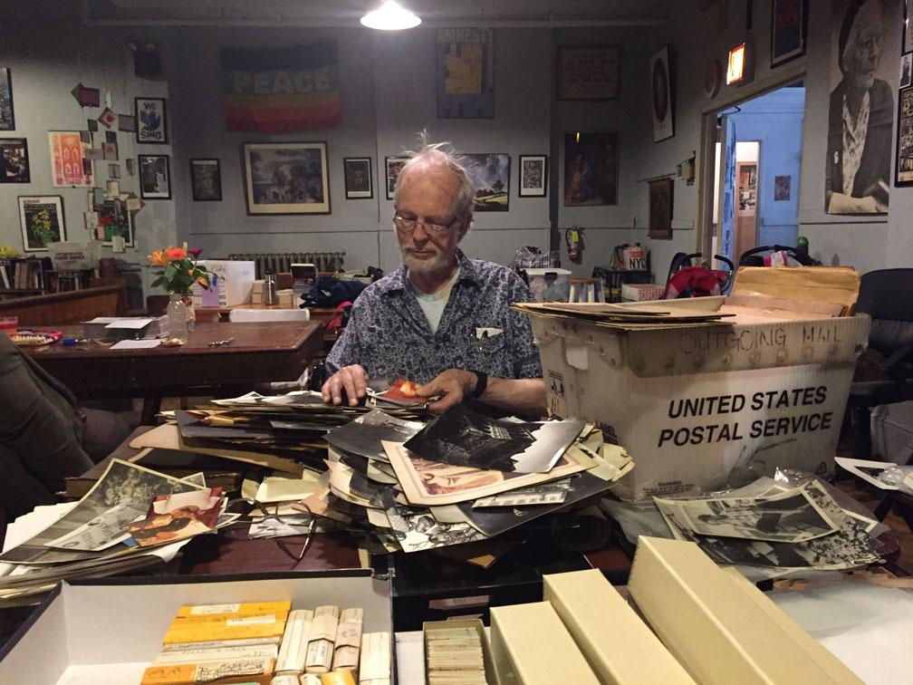 David sorting photos at Catholic Worker Maryhouse in Manhattan, May 2016. Photo by Danya Abt.