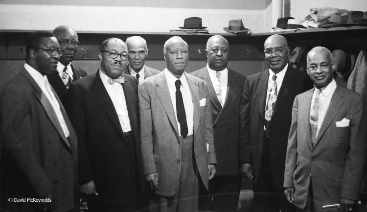 A. Philip Randolph (center, dark tie) was chairman of the event, which was sponsored by the Brotherhood of Sleeping Car Porters and NAACP. Keynote speaker Dr.T.R.M Howard, is third from left. Other IDs will be added as we get them.
