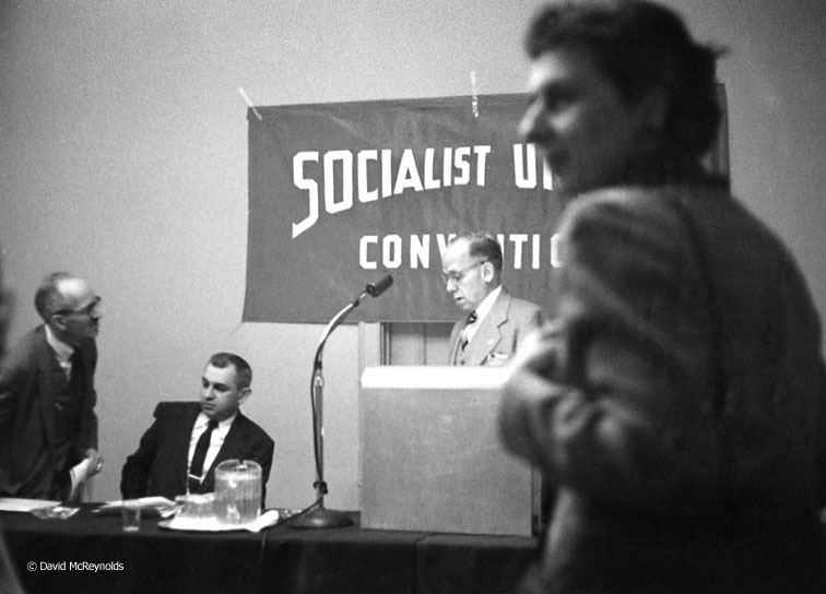Herman Singer (seated), Darlington Hoopes at microphone, Robin Myers (right). Singer was Executive Secretary of the SPA from 1954-1957. Darlington Hoopes was the party's presidential candidate in 1952 and 1956. Myers was Executive Secretary from 1950-1954. (57-3)