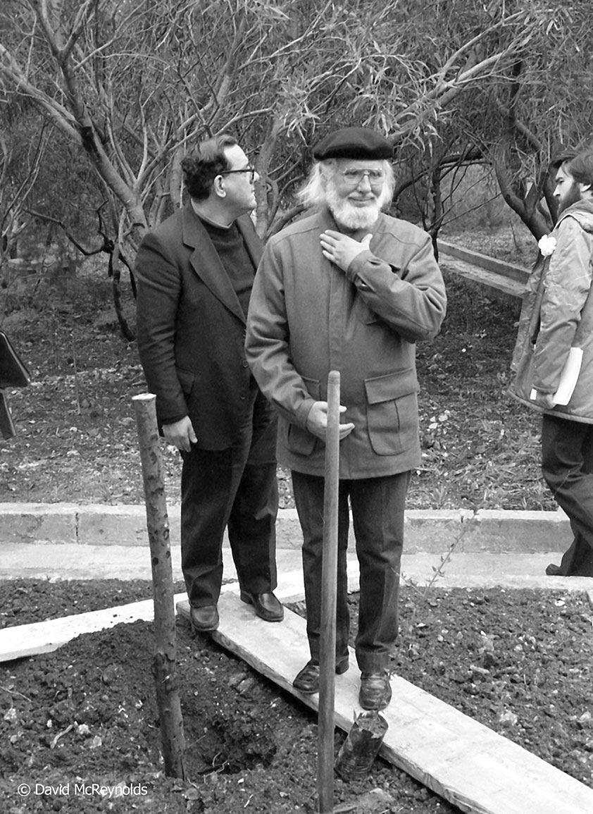 During the conference the group, including the Nicaraguan poet Ernesto Cardenal (front) planted olive trees on the Peace Lab property, the center that hosted the conference. The Peace Lab takes in refugees today. Fr.Dionysius Mintoff, a franciscan friar and Peace Lab founder, is behind Cardenal.