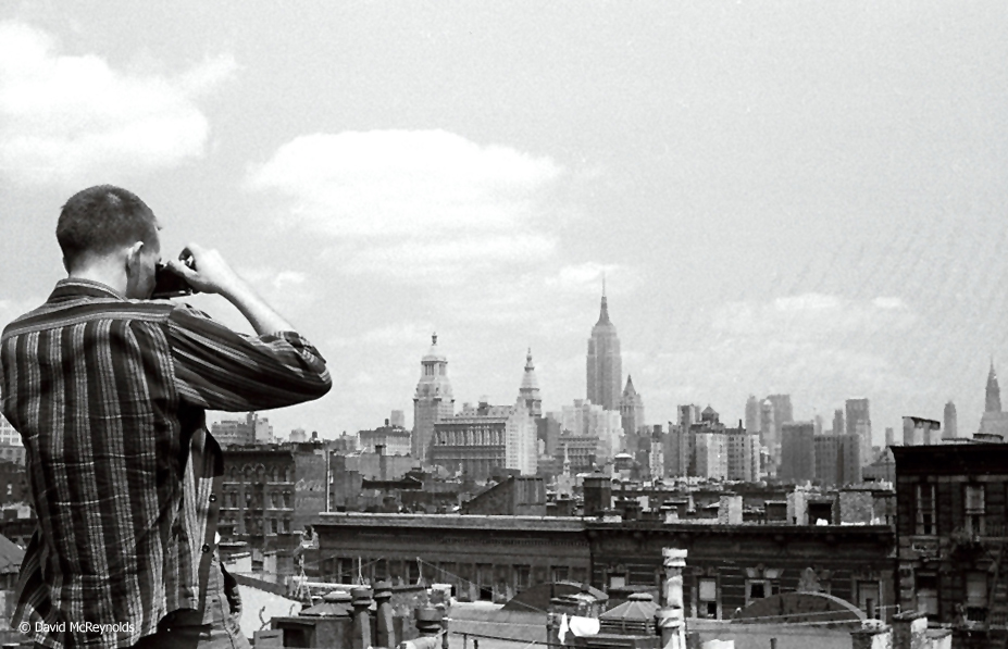 Ben Jaxon and the city from David's apartment building roof at 92 E. First Street, 1957.