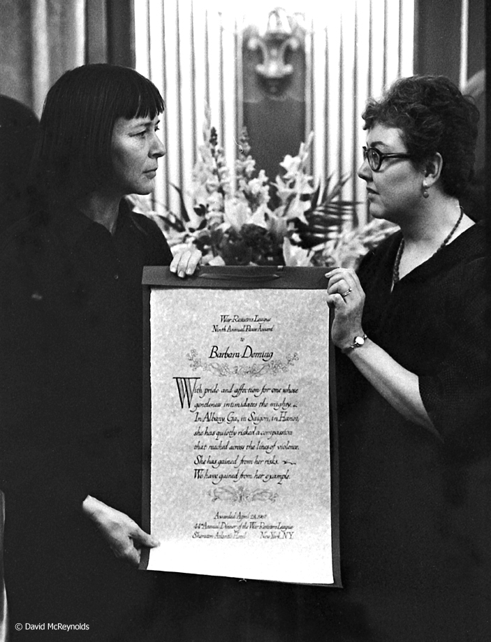 Barbara Deming (left) receives the War Resisters League Peace Award in 1967. Artist Janet Toy presented the award.