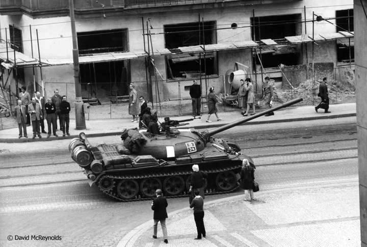 """Prague was to be my holiday, four days between two conferences."" On David's last morning in Prague, August 21, 1968, Soviet tanks rolled into the city and David captured some of the action from his hotel window and in the streets."