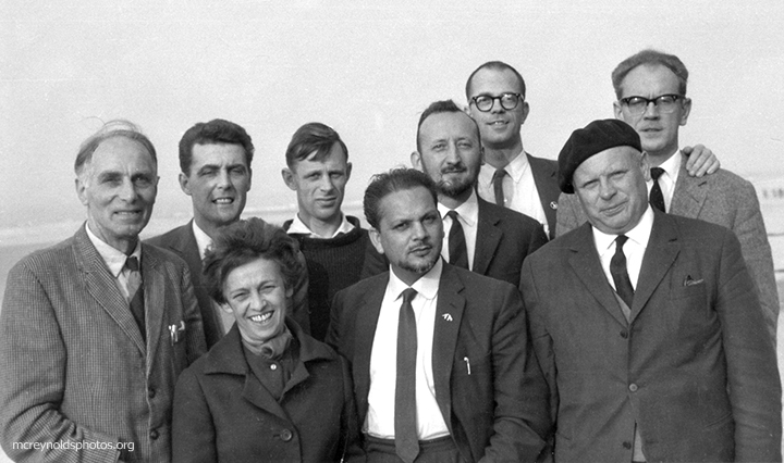 At a 1964 War Resisters' International meeting in Ostend, Belgium, between representatives of WRI and the World Peace Council. Left to right: Harold Bing, WRI; rep from World Peace Council; Madame Rosy Holender, General Secretary of the Belgium Union for the Defence of Peace; Michael Randle, Devi Presad, Jan Van Lierde, David McReynolds all representing WRI; no ID; Stanislaw Trepczysnki, Member of the Presidential Committee of the Polish Peace Committee.  War Resisters League files.