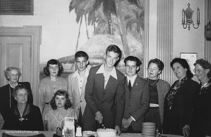 David, cutting cake, launched into activism with the Youth Temperance Council of which he was the Southern California Chapter President. His brother Martin is on his right. 1948.