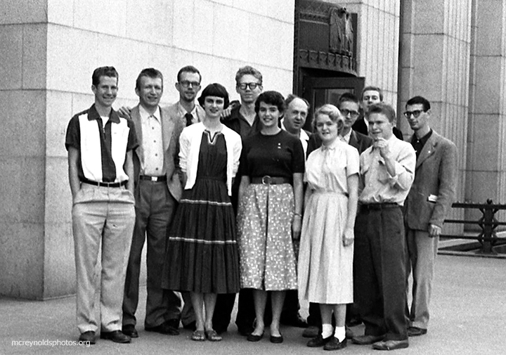 "Recently graduated from UCLA, David was arrested for refusing the Korean War draft. His case was dismissed on a technicality in March 1955 in Los Angeles, and he met his ""Pasadena group"" supporters outside the court. Men's row, left to right: Rocky Spoelstra, Harry Sittonen, David, Rex Backus, Charles Curtis, Doug Pomeroy, Frank Hamilton (partly hidden), Tom Klopfer. Front: Leora Rundstrom, Kate Collins, Kelly Pomeroy, Hank Maiden. (55-5)"