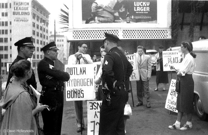 Marchers and police at 2nd and Hill in downtown Los Angeles. Armed Forces Day march in downtown Los Angeles, May 15, 1954. (54-8)