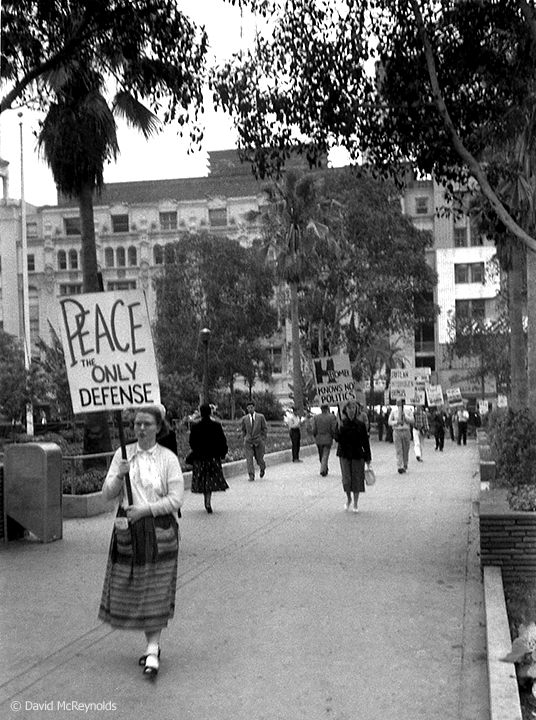 """Peace is the only defense."" Armed Forces Day march in downtown Los Angeles, May 15, 1954. (54-8)"