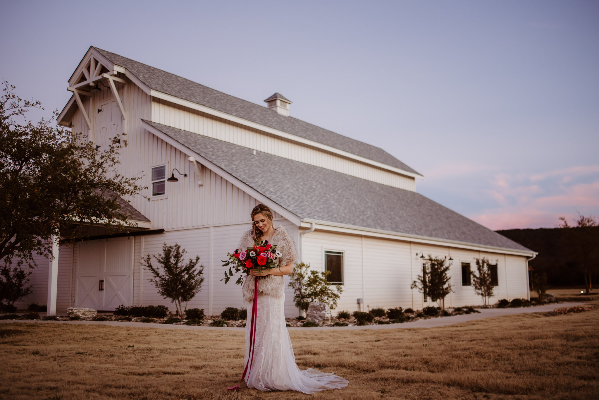 Sabrina Cedars - Sabrina Cedars is an elegant white barn that stands out perfectly against the West Texas sky, Abilene's scenic hills all while beautifully surrounded by West Texas greenery. Sabrina Cedars is about 15 minuets outside of Abilene which means it's one of the most beautiful and easily accessible wedding venues to Abilene brides who are looking for something outdoorsy, tucked away and elegant.
