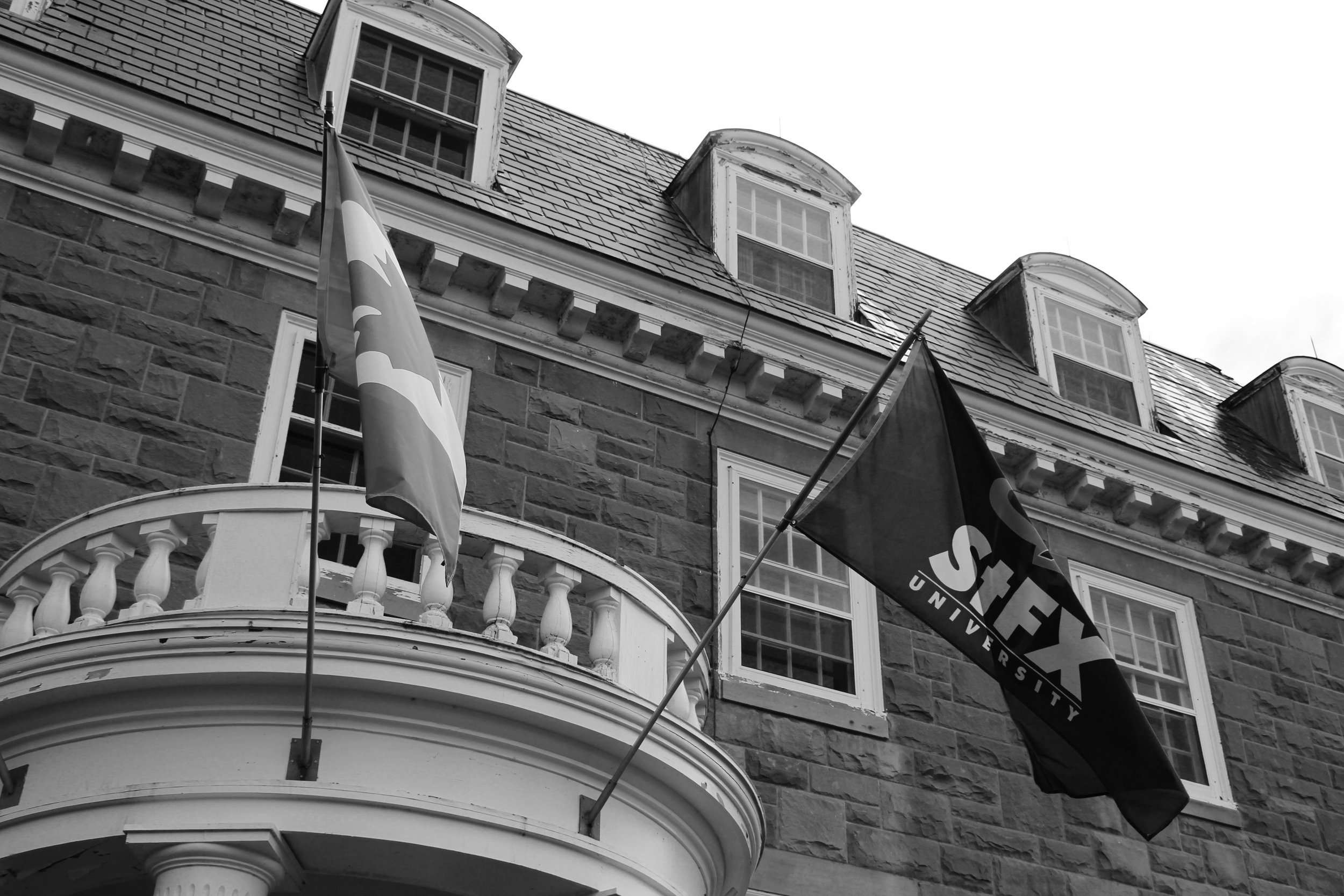 Outside Morrison Hall only 2 flags continue to fly. Photo by Evan Perry.