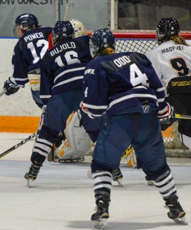 Oddy and the StFX X-Women in action. Photo Credit: David Morash