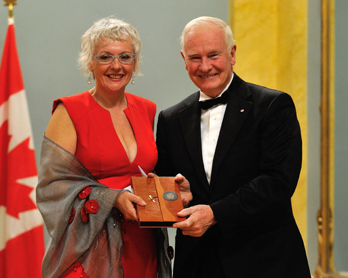Catherine banks received a specially bound copy of her play, it is solved by walking, from governor general david johnston after winning the 2012 governor general literary award for drama. photo: dany veillette / Rideau Hall (The Walrus).