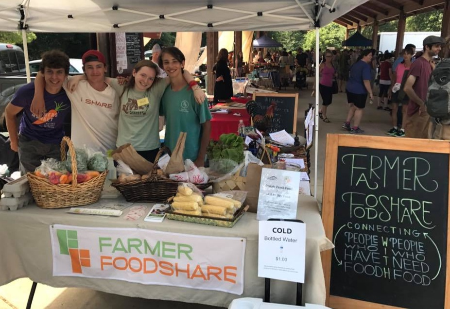 The author, center, with friends at the Eno River Farmer's Market Donation Station