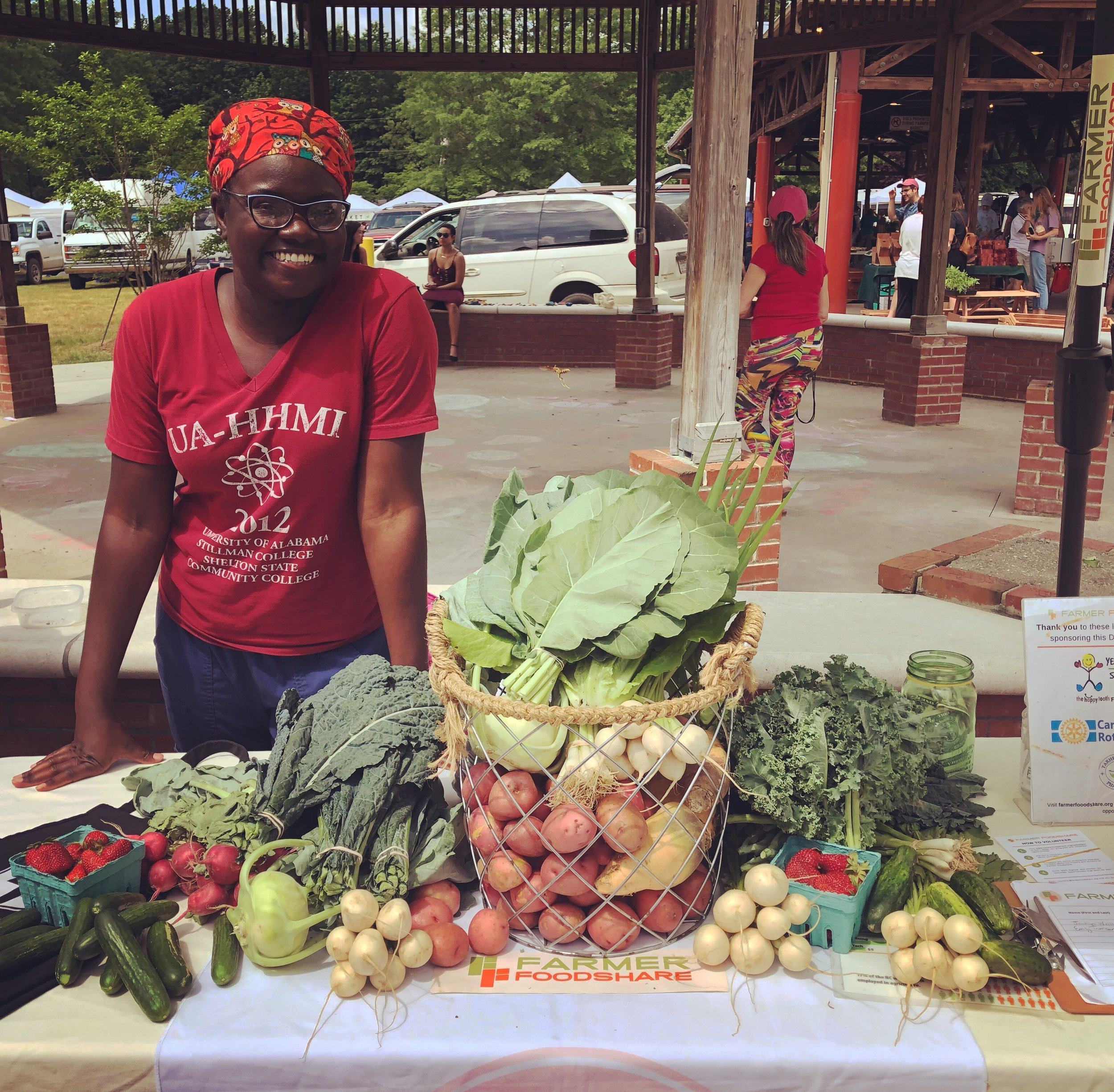 Ronneshia the Volunteer at the Farmer Foodshare  Donation Station in Carrboro