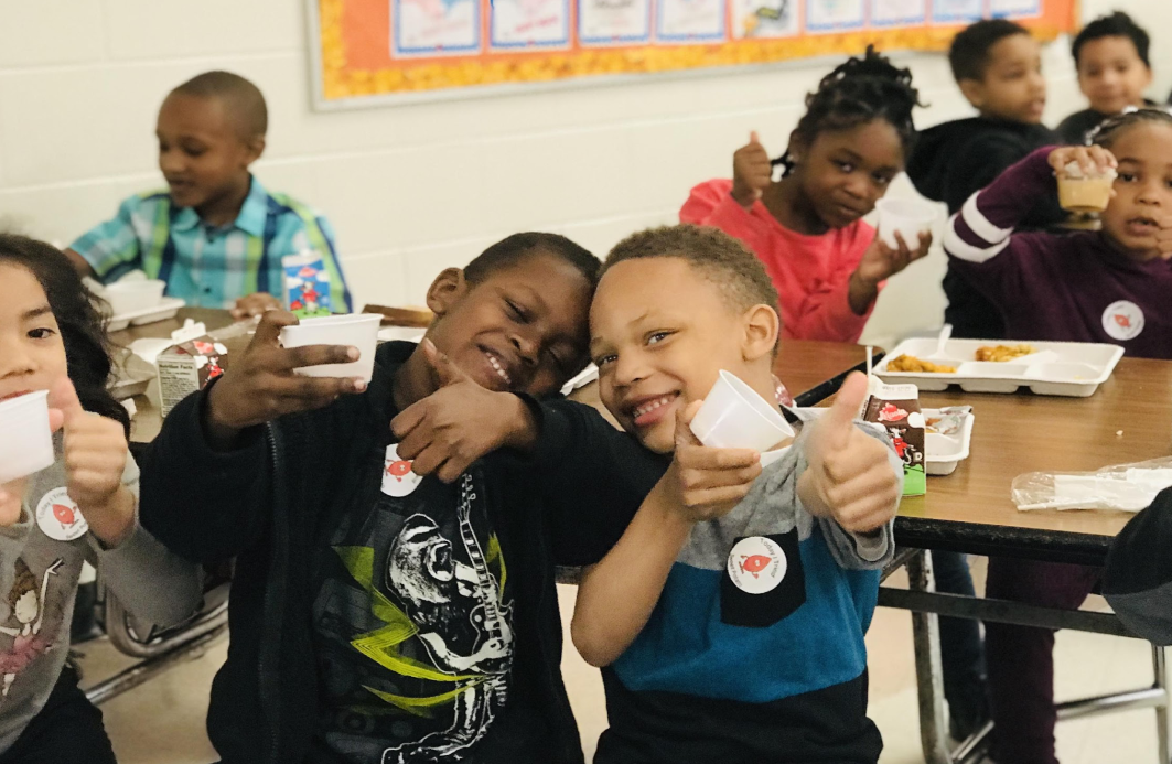 Empty sampling cups mean students gave fresh veggies a big thumbs up!