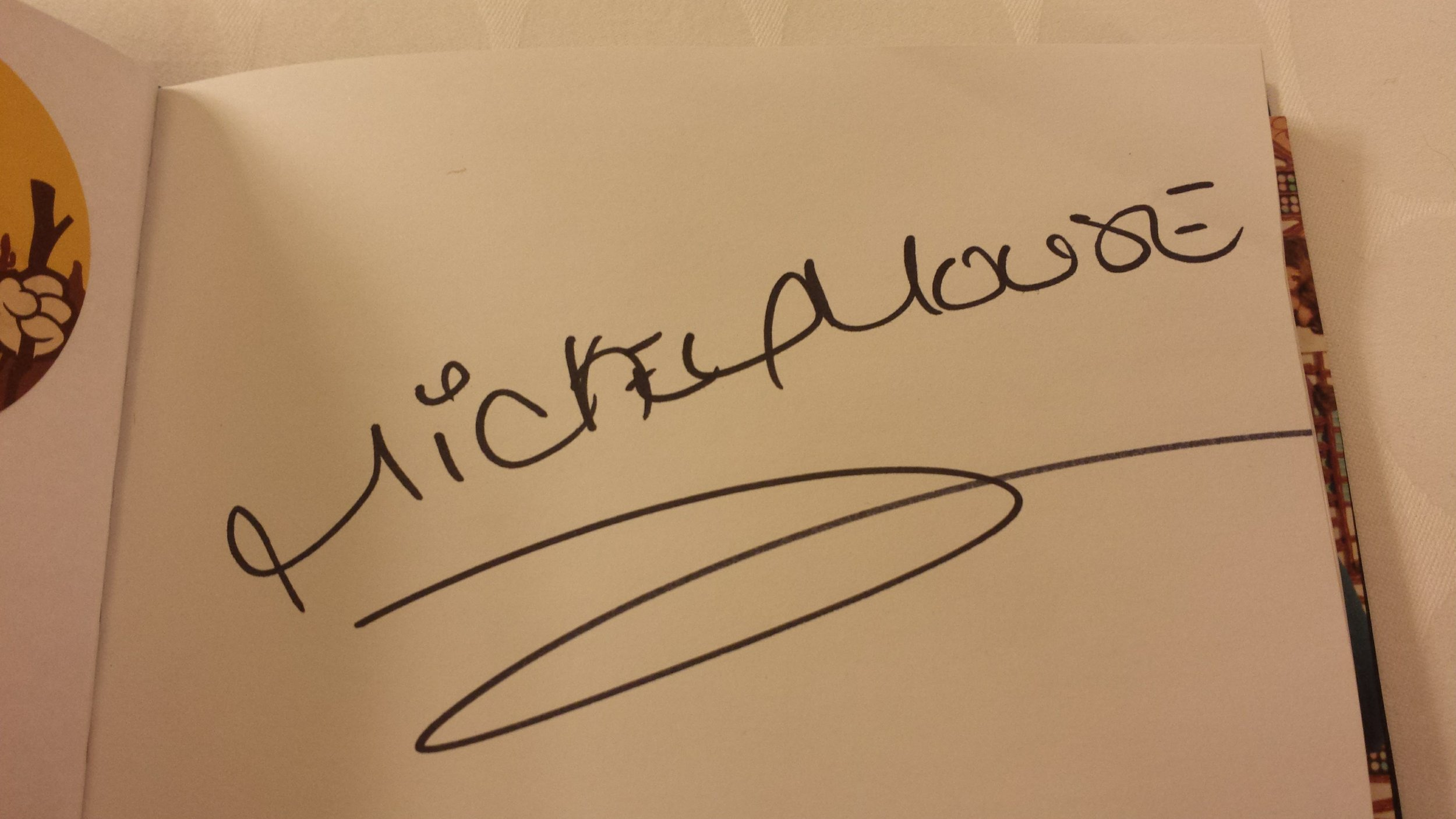 An autograph of mickey mouse.
