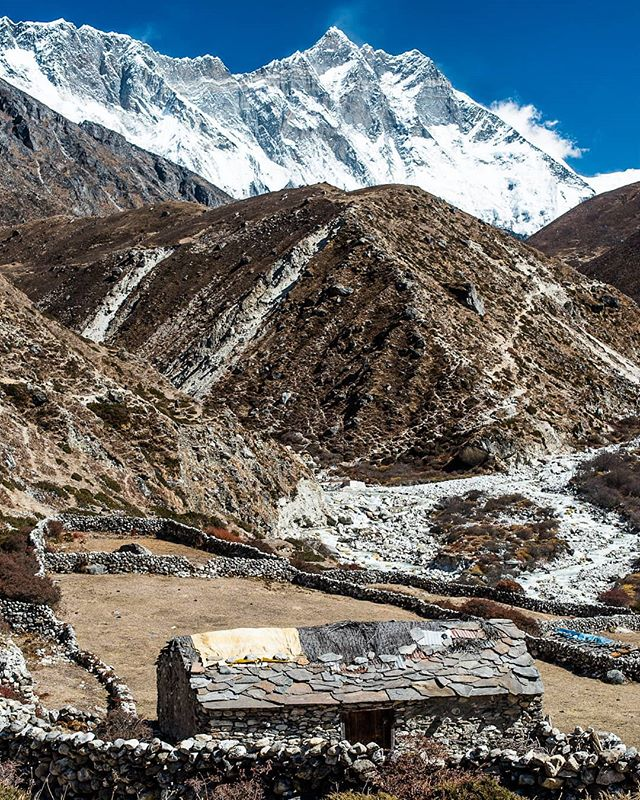 Can you imagine living here?! Aside from the scenery check out the trail across the lower mountain, the stone walls, the plotted farm land, and the roof on that house. #lovenepal