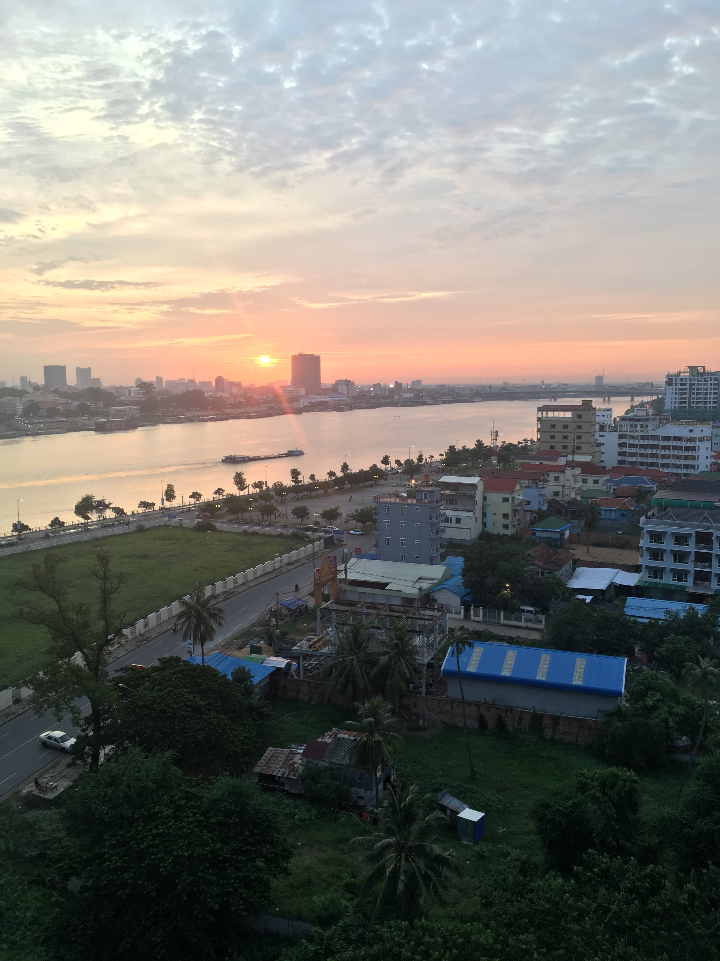 Sunset view over the Tonle Sap river, from the Outpost rooftop
