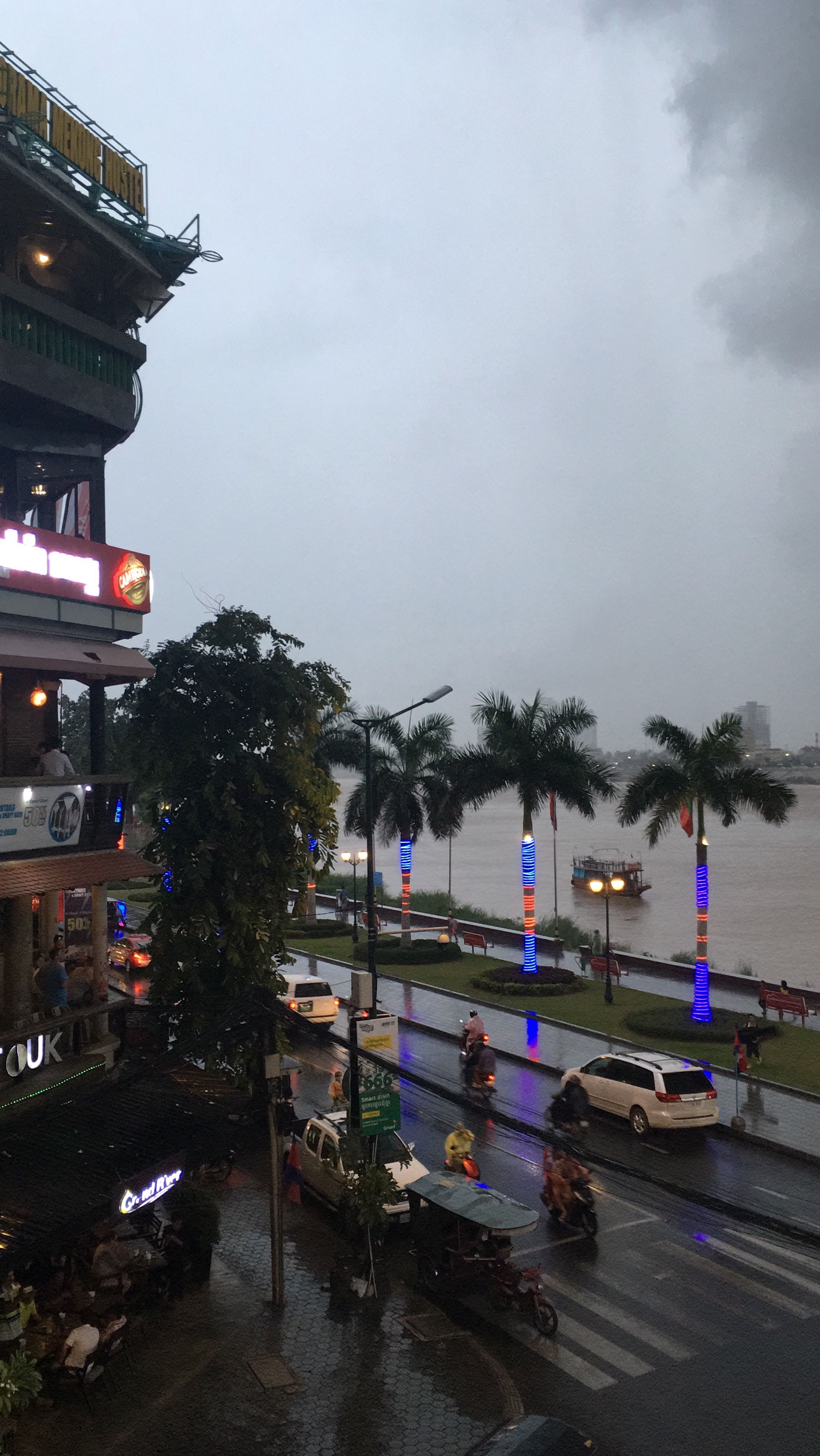 Watching the rain come down at the Foreign Correspondents Club along the riverside in Phnom Penh