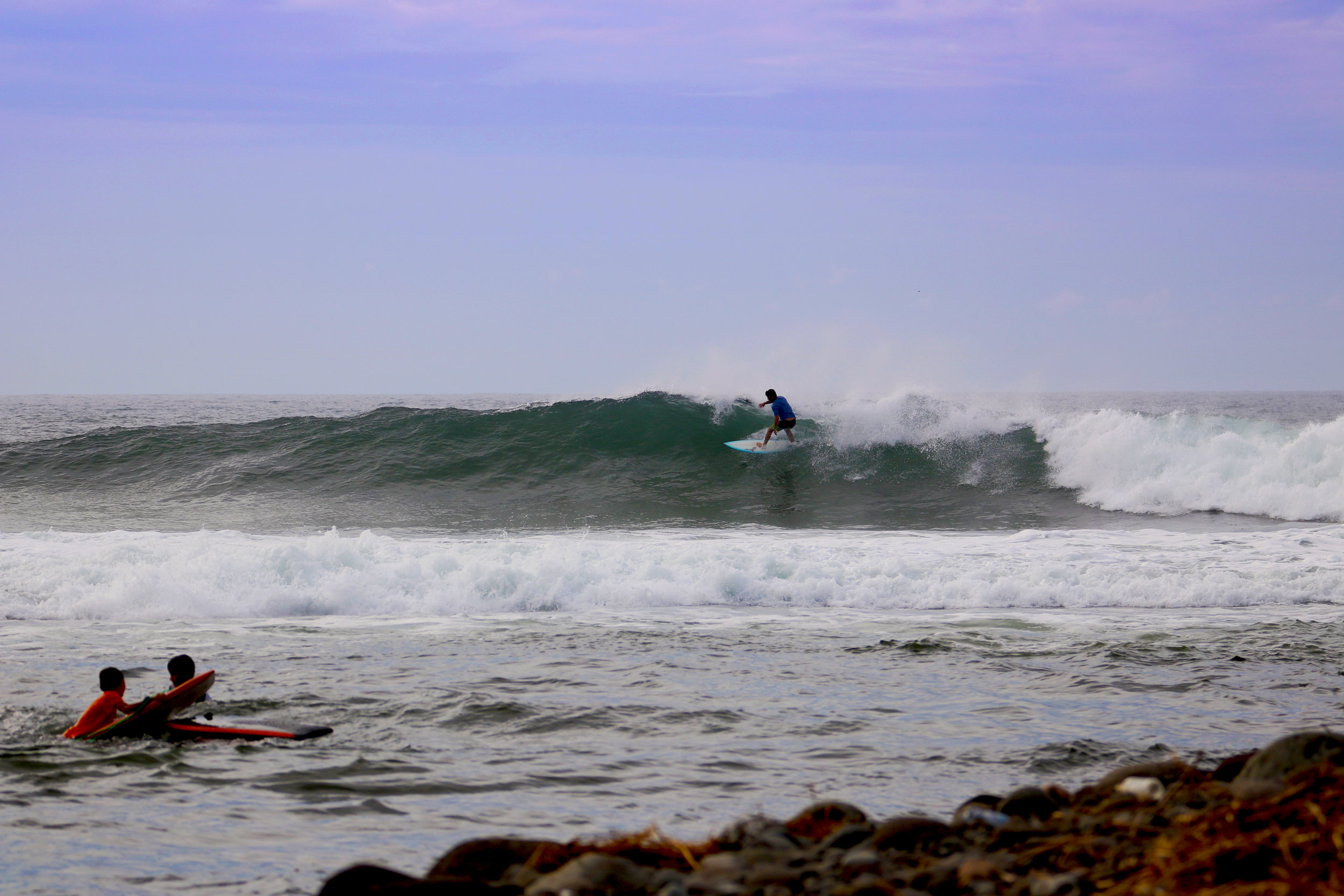 Sharing a few waves with the locals.