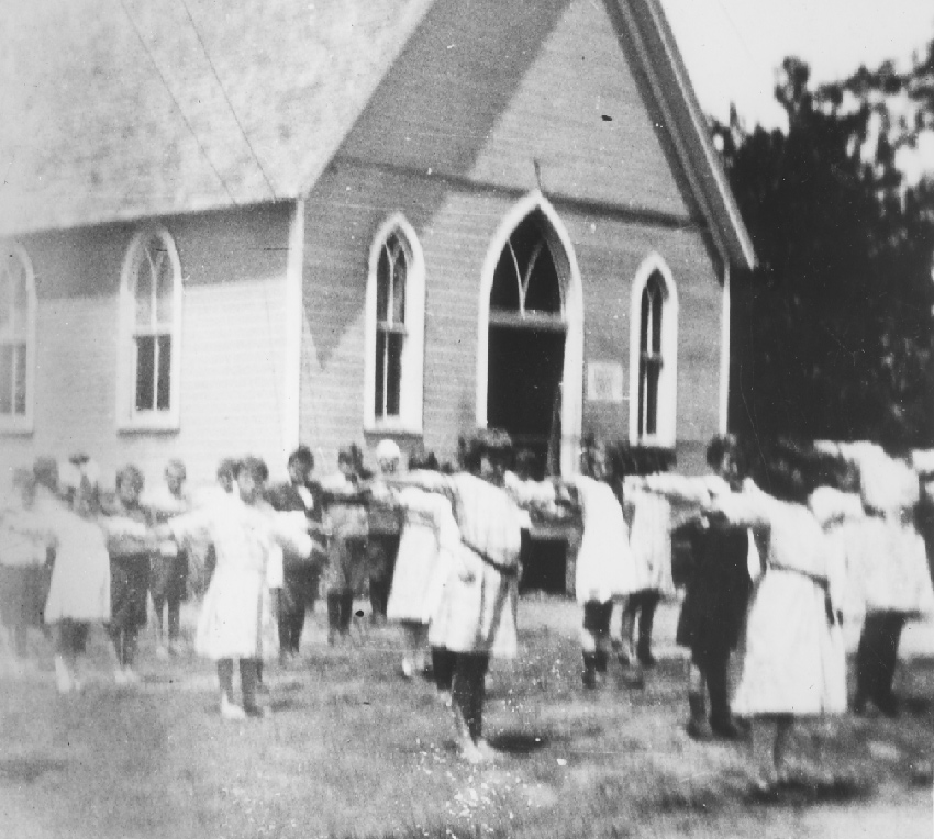 School class exercising in the Community House yard about 1920