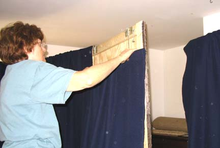 Hanging the drapes.