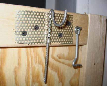 Hangers turn sideways to permit folding the peris.