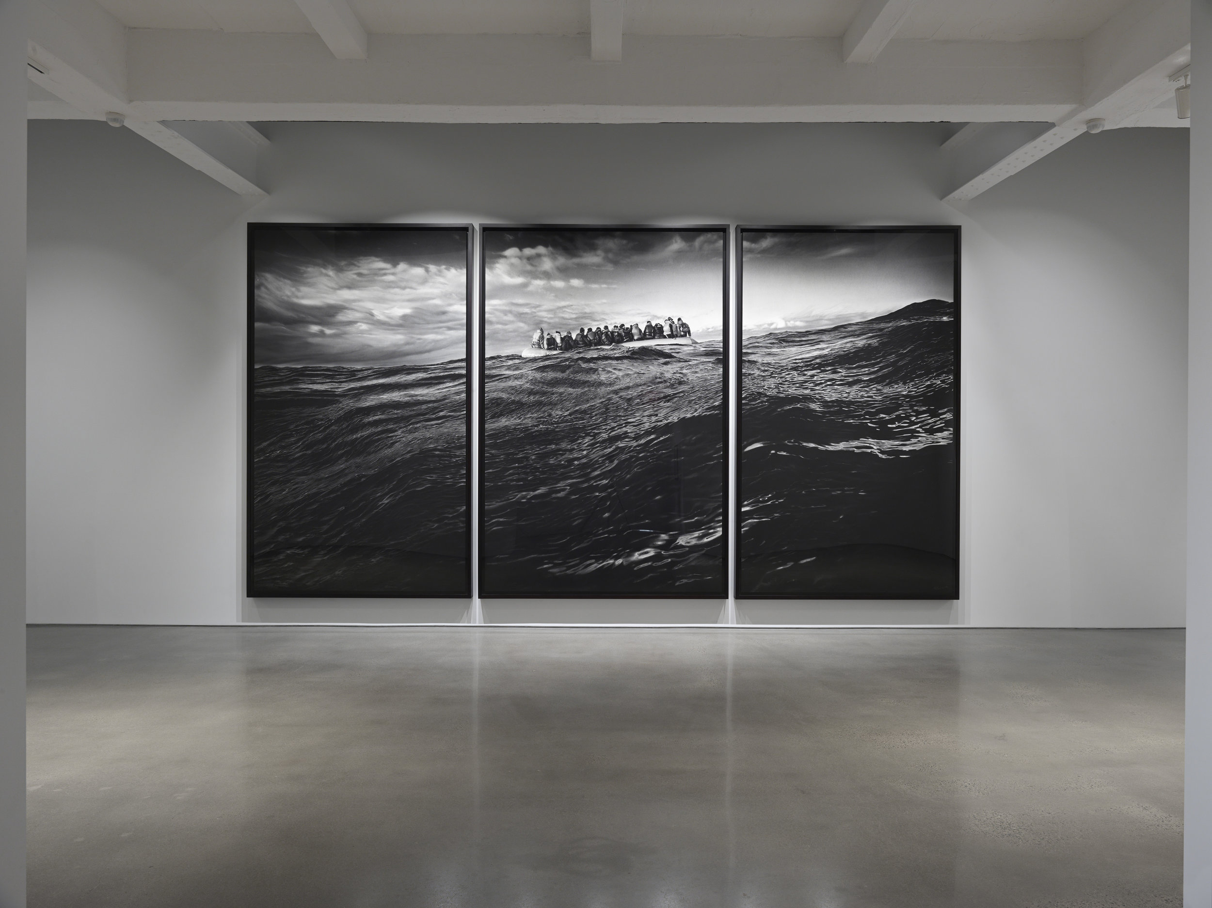 Robert Longo, Untitled (Raft at Sea) , 2016. Charcoal on mounted paper, 140 x 281 inches (355.6 x 713.7 cm) overall. Courtesy of the artist and Metro Pictures, New York