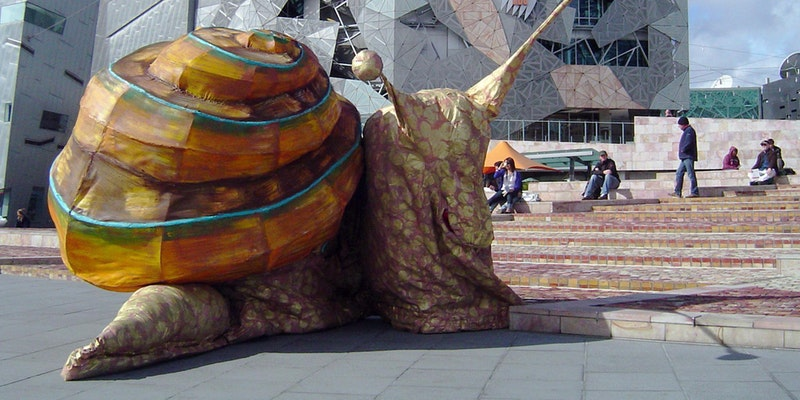 Image credit:Snail by Snuff Puppets at Federation Square 2009. Image courtesy Snuff Puppets.  This event is part of Melbourne Design Week 2018, an initiative by Creative Victoria in partnership with NGV.  This event is sponsored by the City of Melbourne Community Grant.