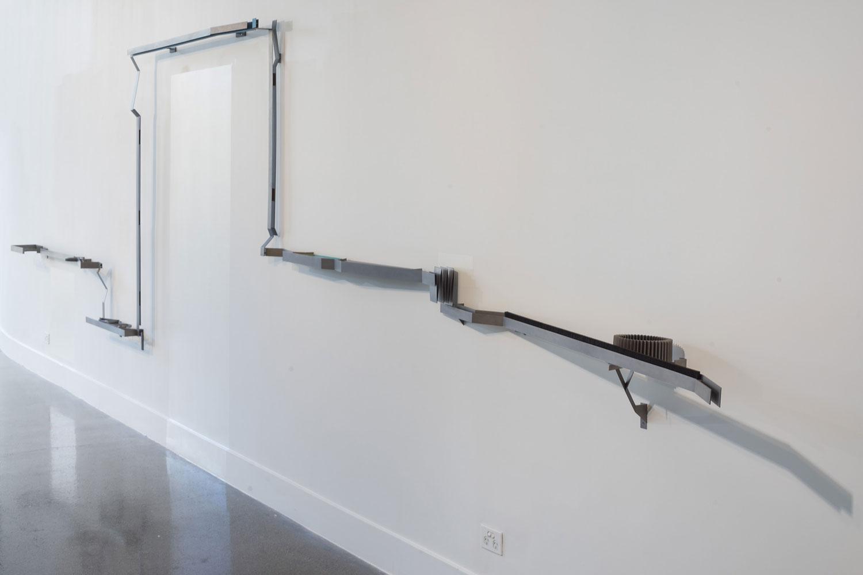 Mark Edgoose,  Domestic rail,  2015, Titanium, niobium, steel, nylon, 1600 x 4500 x 480mm. Image courtesy the artist.